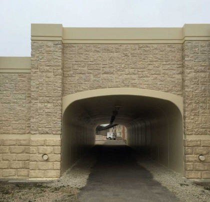 Arched, precast concrete bridge sections well suited to Joliet, IL Metra Station Pedestrian Passageway