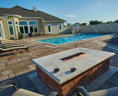 Crest™ Bullnose Pavers and Summit<sup>®</sup> Stone Landscape Units Create Custom Features on Backyard Patio