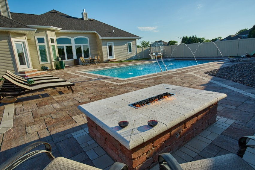 Crest™ Bullnose Pavers and Summit® Stone Landscape Units Create Custom Features on Backyard Patio