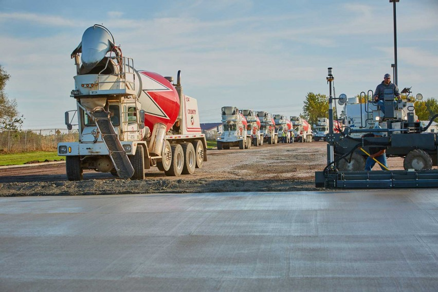 Ready-Mix Overlay Repairs Damaged Asphalt Parking Lot