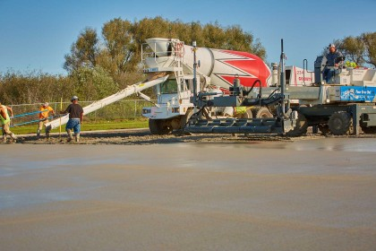 Ready-Mix Overlay Repairs Damaged Asphalt Parking Lot